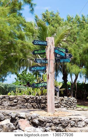 direction signpost to many different countries in caribbean island Barbados