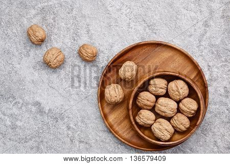 Walnuts On Rustic Background. Walnuts Kernels And Nutcracker. From The Top View.