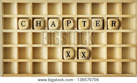 An image of a wooden game with the word chapter twenty