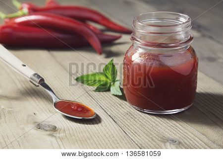 portrait of red chili peppers confiture lying on a teaspoon