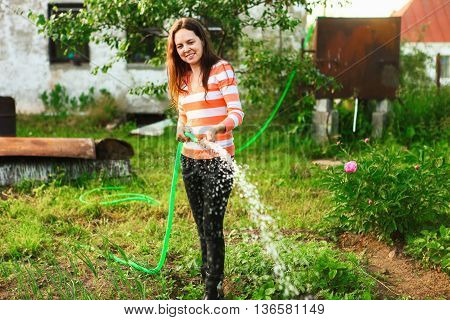 Young Woman Watering.