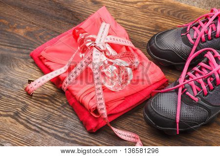 Sports Sneakers, Tape Measuring And Sports Bra