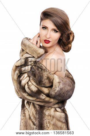 Beautiful woman in fur coat looking at camera