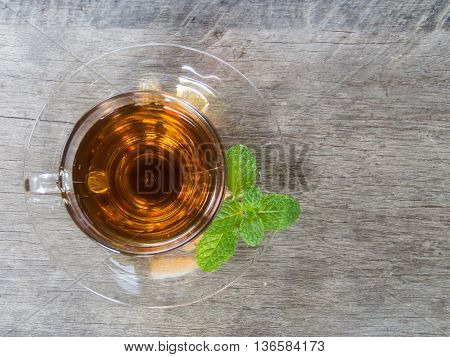 Top view tea cup  and mint on wooden background