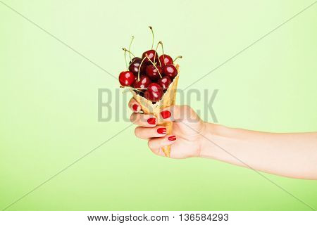 Waffle Cup With Cherries In The Hand