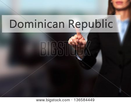 Dominican Republic - Businesswoman Hand Pressing Button On Touch Screen Interface.