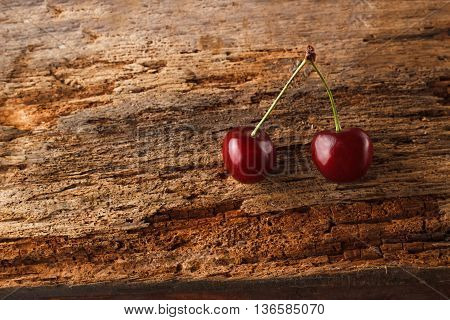 Two Cherries On The Old Wooden Board