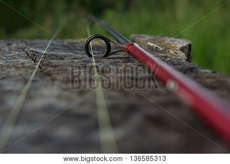 Fishing rod on wooden background outdoor, hobby