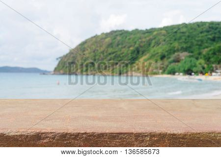Vintage stone board empty table in front of blue sea & sky background. Perspective stone floor over sea and sky - can be used for display or montage your products. beach & summer concepts.