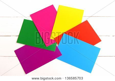 A set of bright colored cardboard isolated on white background. Red, yellow, green, blue, purple, pink carton sheets. Paper supplies for kids craft and creativity