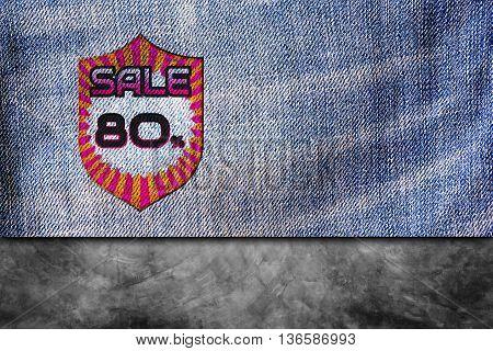 Sale discount labels. 80% off on blue denim jeans background.