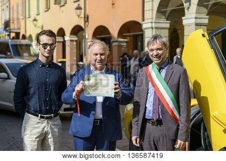 Sant'Agata Bolognese, Italy - April 30, 2016: Tonino Lamborghini and son together with the Mayor of Sant'Agata Bolognese , Giuseppe Vicinelli , during the parade for the 100th anniversary Ferruccio Lamborghini
