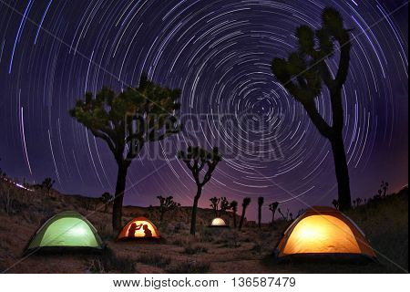 Illuminous Light Painted Landscape of Camping and Stars