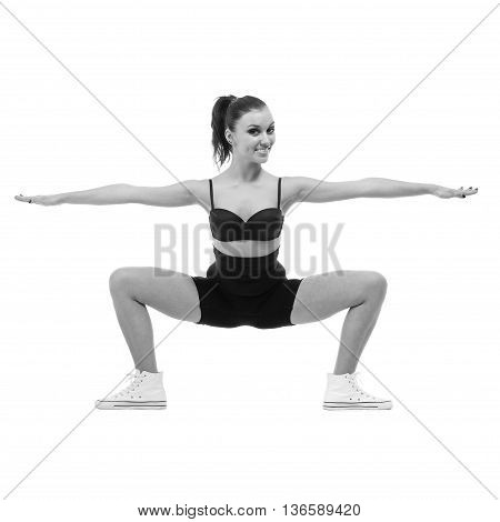 colorless portrait of cute woman gymnast, isolated on white in full length