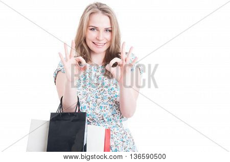 Beautiful Female With Shopping Bags Showing Ok Sign