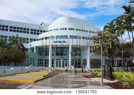 MIAMI BEACH, UNITED STATES - FEBRUARY 11: People clean up near Miami Beach Police building on 11th of February, 2016 in Miami Beach.