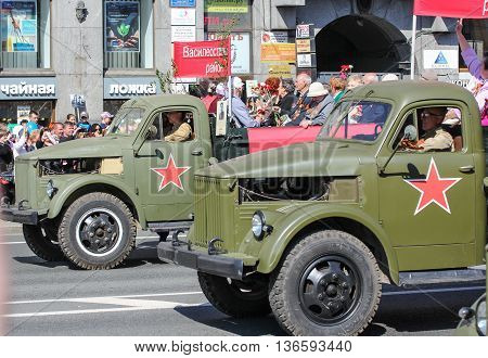 St. Petersburg, Russia - 9 May, Military vehicles with people, 9 May, 2016. Holiday-action