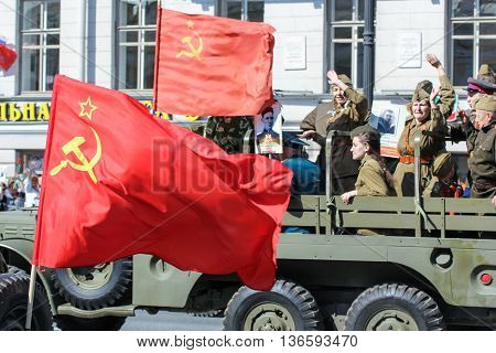 St. Petersburg, Russia - 9 May, People in the car in the form of flags, 9 May, 2016. Holiday-action