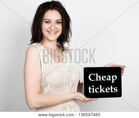 technology, internet and networking - close-up successful woman holding a tablet pc with cheap tickets sign. internet technology in tourism.
