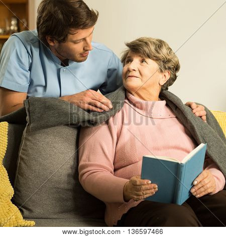 Nurse Caring About Senior Patient
