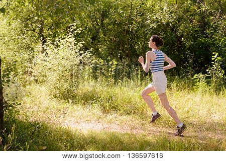 Senior Woman Running In The Forest