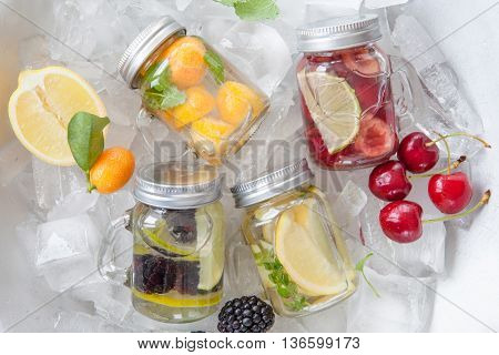 Infused water with fresh fruits in vintage jars