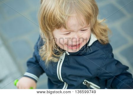 Little Boy Cries On Bicycle