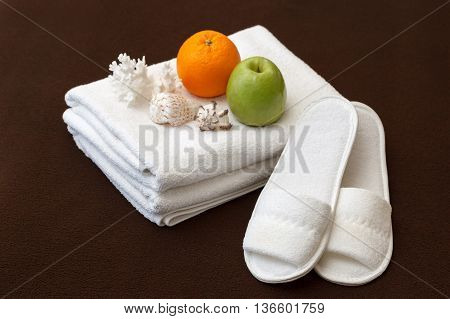white towels and Slippers in the hotel room