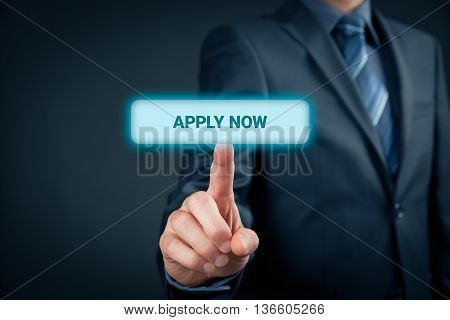 Businessman click on button apply now - human resources concept.