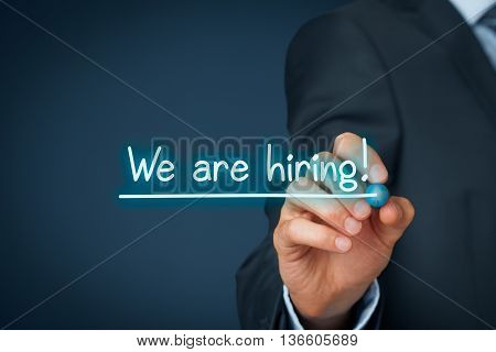 Headhunter (recruiter) write and underline text we are hiring - human resources (HR) concept.