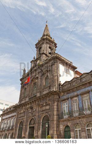 PORTO PORTUGAL - MAY 26 2016: Trinity Church (Igreja da Trindade circa 19th c.) in the historical center of Porto Portugal (UNESCO site). Architects Carlos Amarante and Jose Francisco