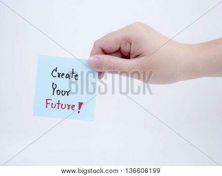 Single smart business woman hold handwriting create your future on notepad in right hand on isolated / white background