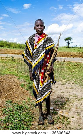 Teenager Maasai In Traditional Clothes