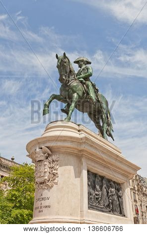PORTO PORTUGAL - MAY 26 2016: Monument (circa 1866) to King Dom Pedro IV (the Liberator) at Liberdade Square in the historic center of Porto (UNESCO site). Work of sculptor Celestin-Anatole Calmel