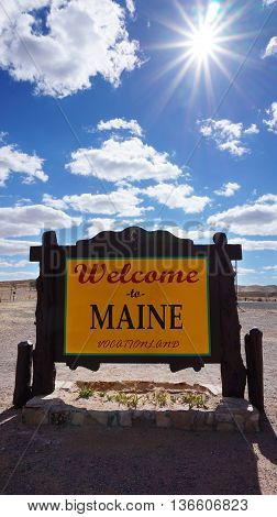 Welcome to Maine road sign with blue sky