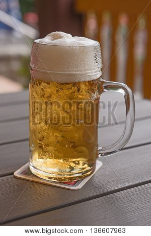 Beer mug on a table in a pub