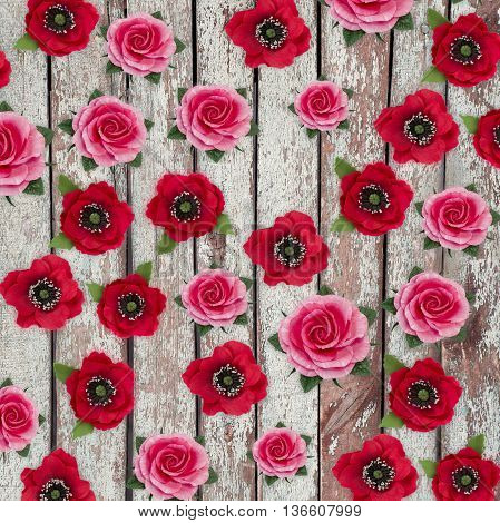 Abstract background of flowers.Handmade flower fabric foamiran. Beautiful flowers made of sponge rubber. Poppies and roses on vintage wooden background