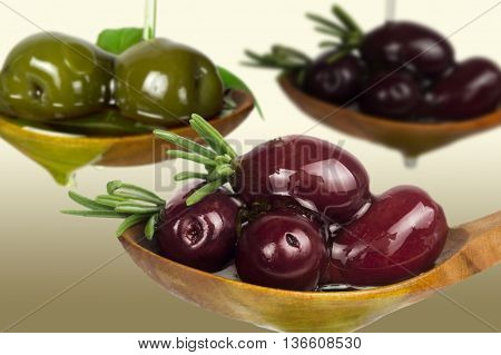 red, black and green olives in oil