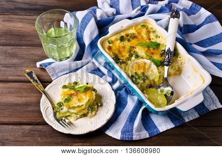 Casserole with zucchini and green peas. Selective focus.