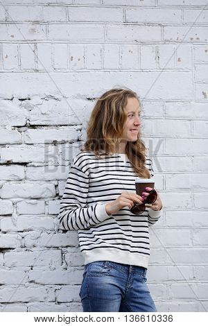 Smiling Girl With A Disposable Coffee Cup