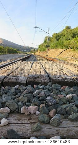 Railway crossing in rural cut with wooden sleepers near Alora Andalucia