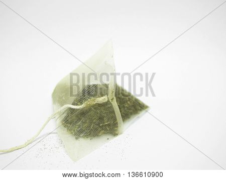 green tea bag isolated on white background