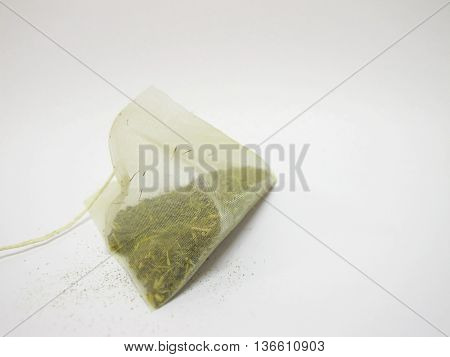 isolated green tea bag on white background