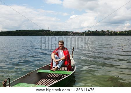 man in a boat on the lake