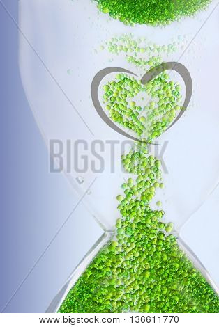 Bubbles forming heart shape. Background of green bubbles.