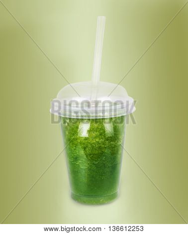 Green smoothie with a straw. Vegetable cocktail. Healthy organic drinks concept.