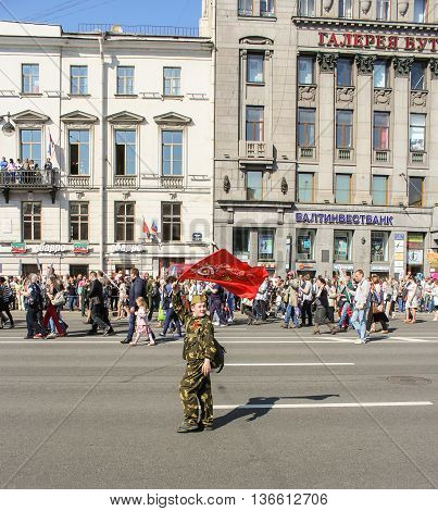 St. Petersburg, Russia - 9 May, A teenager with a flag in his hand, 9 May, 2016. Holiday-action