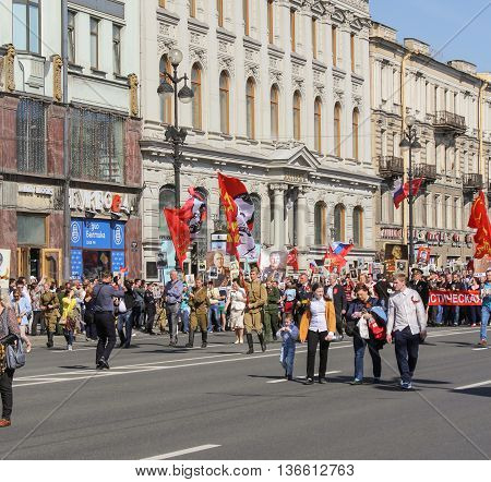 St. Petersburg, Russia - 9 May, People in the form of a red flag, 9 May, 2016. Holiday-action