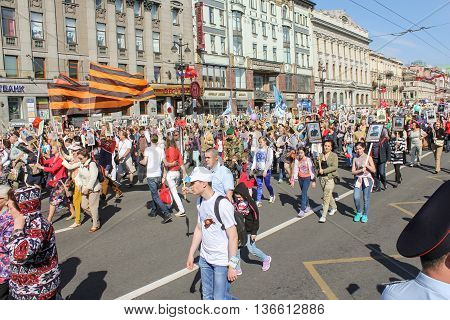 St. Petersburg, Russia - 9 May, People with portraits under the flags of St. George, 9 May, 2016. Holiday-action