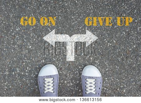 One standing at the crossroad choosing what to do next - go on or give up